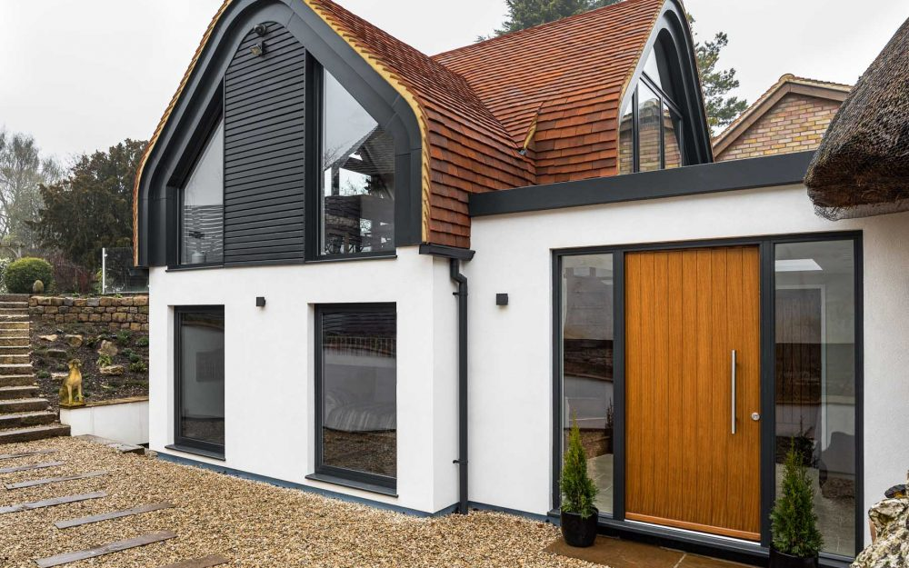 Contemporary home extension to a thatched cottage