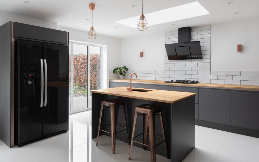 Dark grey kitchen with copper fixtures