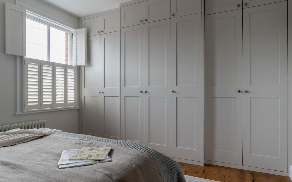 Fitted wardrobes bathed in soft natural light