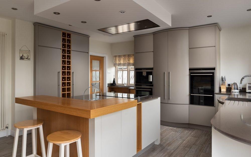 Neutral coloured designer kitchen with island