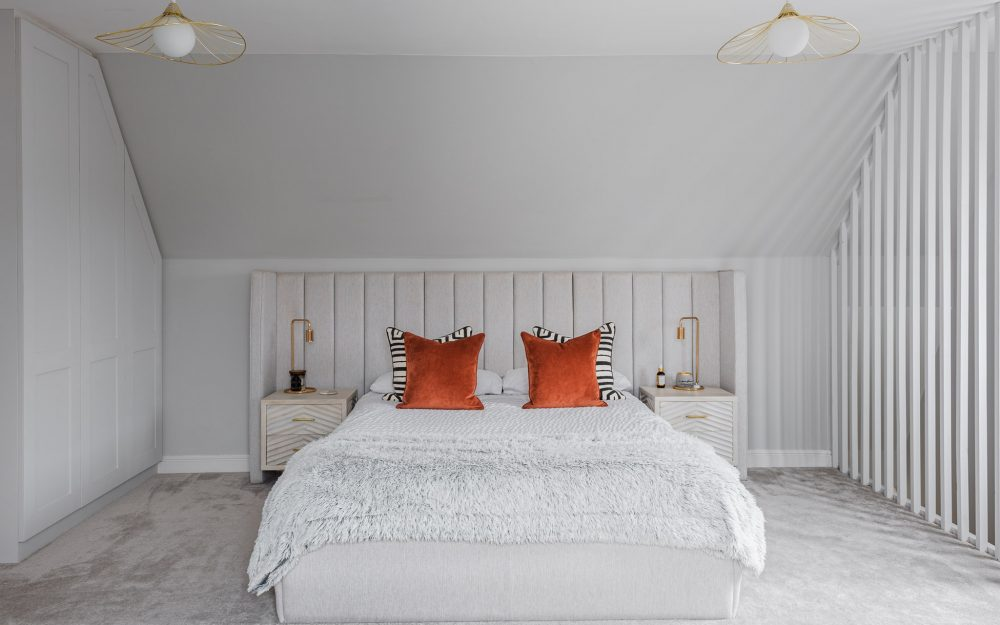 Double bed with orange and zebra stripe cushions