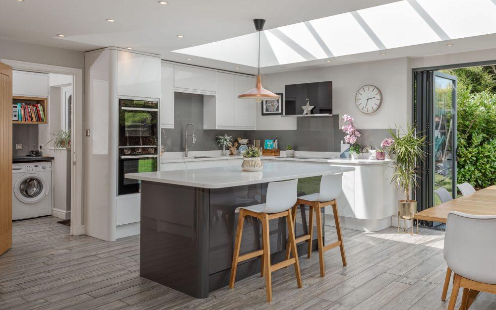 White glossy kitchen with sunny garden
