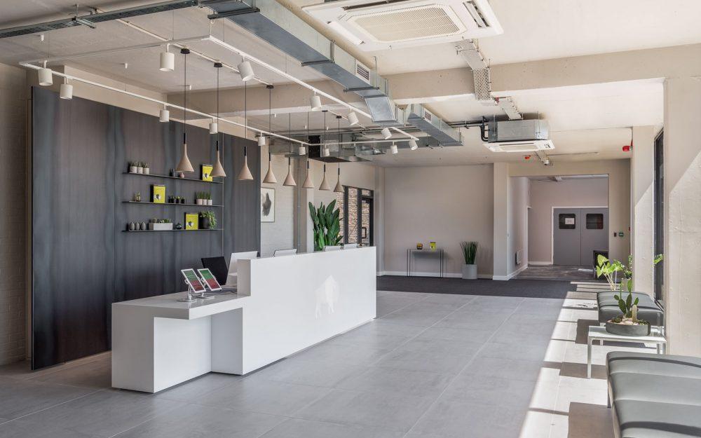 Neutral toned commercial reception desk space